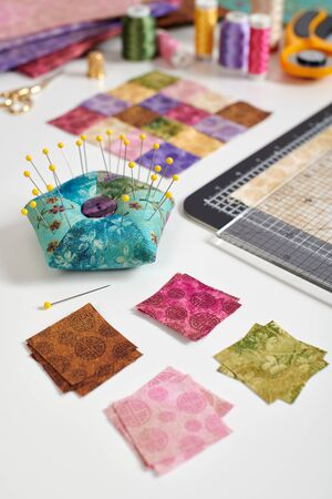 Square pieces of colorful bright fabrics for making quilt, pincushion, quilting block, sewing and quilting accessories