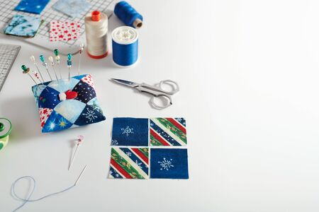 Preparing of square pieces of fabrics for sewing quilt, pincushion,  sewing and quilting accessories