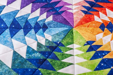Fragment of hexagon patchwork block like kaleidoscope, detail of quilt, colors of rainbow Standard-Bild