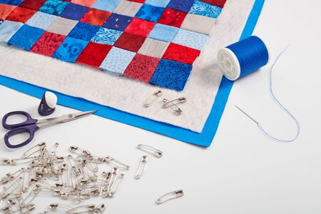 Assembling of a quilt sandwich, curved basting pins and sewing accessories