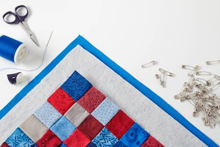 Assembling of a quilt sandwich, curved basting pins and sewing accessories 写真素材
