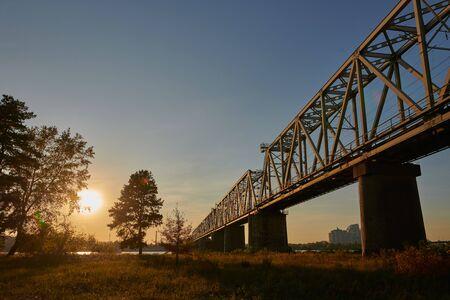 Railway bridge over the Dnieper River in Kyiv, Ukraine at sunset