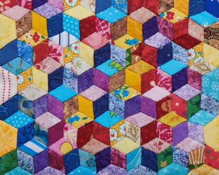 Detail of quilt sewn from diamonds and has view three-dimensional