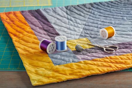 Gray and orange geometric mini quilt, sewing and quilting accessories