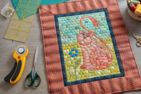 Mosaic mini quilt, surrounded sewing and quilting accessories 写真素材