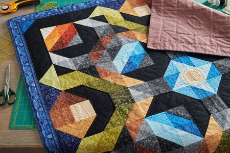 Small quilt, cutting mat and accessories for sewing and quilting