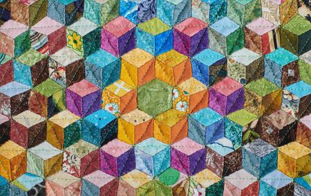 Fragment of quilt sewn from diamonds and has view three-dimensional