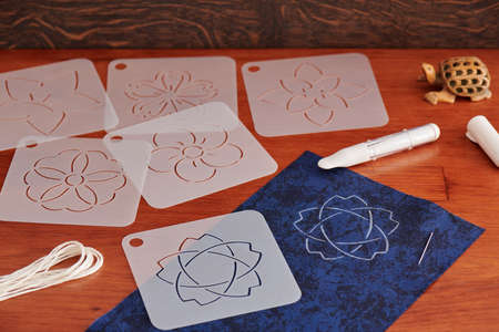 Preparing for Japanese embroidery sashiko. Templates, threads, tailor chalk pen with applicator.