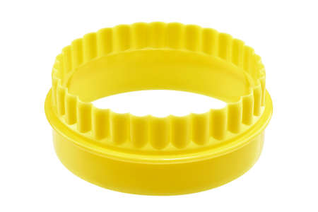Two sided yellow round cookie cutter on a white surface