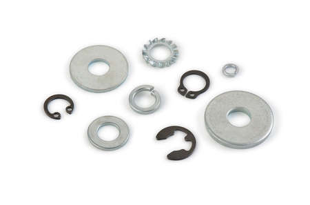Metal washers different shapes and sizes on a white background, cut out, photo stacking