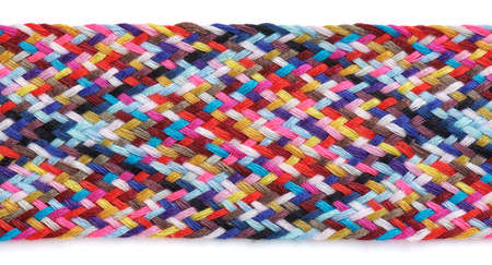 A braid of multi colored sewing threads on a white background Stock fotó