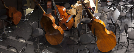 musical instruments on the stage and in the orchestra pit Stock Photo