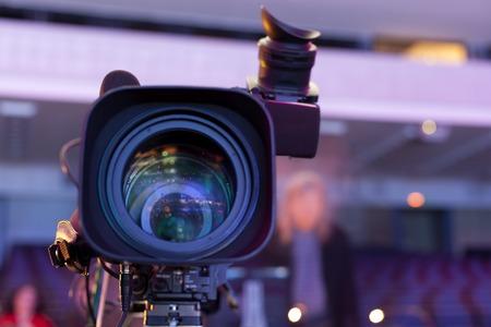 Professional digital video camera. tv camera in a concert hal.  Digital TV camera Foto de archivo