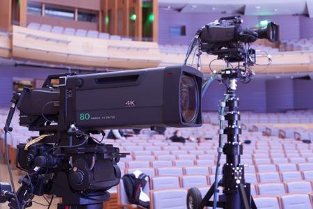 hall monitors: Professional digital video camera. tv camera in a concert hal.  Digital TV camera