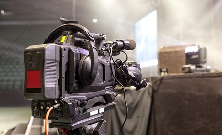tv camera in a concert hal. Professional digital video camera. Stock Photo