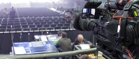 hall monitors: tv camera in a concert hal. Professional digital video camera. Stock Photo
