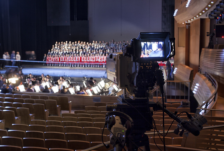 hall monitors: TV broadcast of the event from the theater.