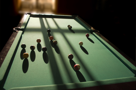 snooker rooms: Sharp shadows on the billiard table from the balls.