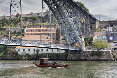 The Dom Lu s I Bridge is a double-deck metal arch bridge that spans the River Douro between the cities of Porto and Vila Nova de Gaia in Portugal. Stock Photo