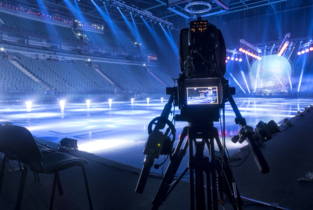 Television broadcast from the ice show. Professional digital video camera. Stock Photo