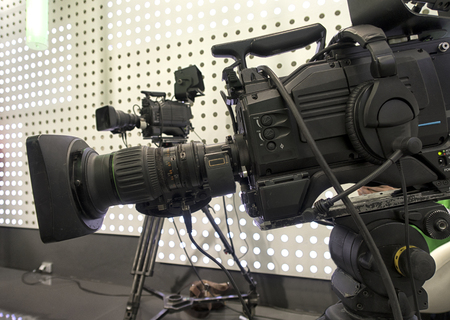 Professional digital video camera. cinematography in the pavilion.