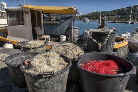 boat fishing nets. Fishing boat equipment detail: net arts macro. Mediterranean sea.