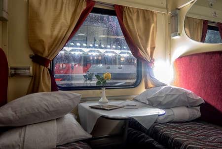 classic interior of sleeping car of train. interior of compartment car. Passenger train car. Sleeping car of passenger train.