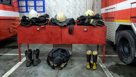 the uniform for firefighters close-up lies on the table and is ready to use. Archivio Fotografico