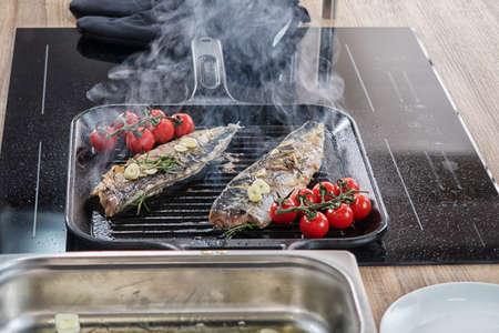 mackerel fried in a cast iron pan