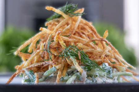 at home, french fries. close-up of finely chopped fried potatoes