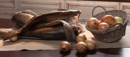 Raw fish. Fish prepared for cooking. Fish and spices on a wooden table.
