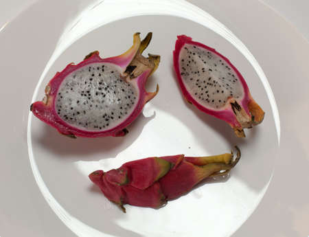 Sweet fresh fruits on plate Standard-Bild