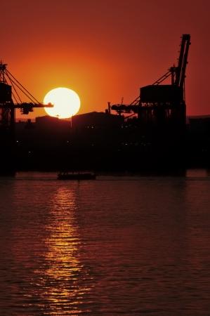 sunsets: Sunset on the cargo port - Taranto Stock Photo