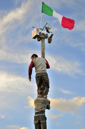 rurale: Greasy pole - campaigns Lecce Stock Photo
