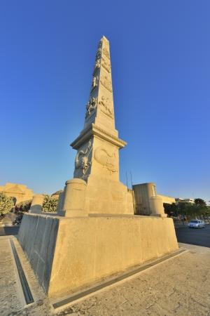 friezes: Lecce - Obelisk of Porta Napoli Stock Photo