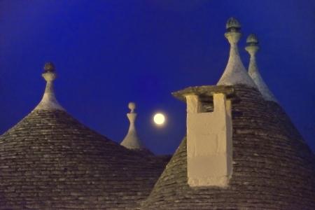 the humanities landscape: Alberobello BA - Trulli and the moon Stock Photo