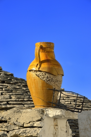 Alberobello - Trulli on decorative amphora