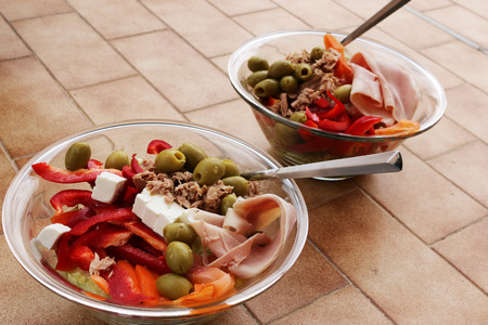 colorfuls: Two healthy and colorfuls salads in glass bowls placed on a tiled floor
