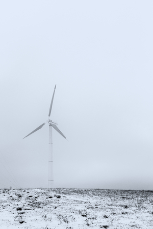 A wind turbine on a mountain covered by snow near Colfiorito town (Umbria, Italy)