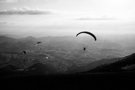 Beautiful shot of some paragliders flying over Monte Cucco (Umbria, Italy)
