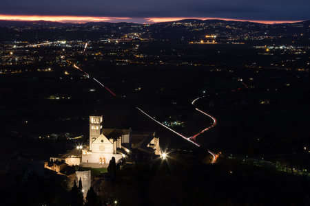 Aerial view of St. Francis papal church in Assisi at night.