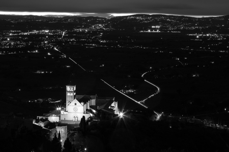 Aerial view of St. Francis papal church in Assisi at night, with Stock Photo