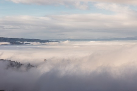 A view of St.Francis church in Assisi (Umbria, Italy) barely visible in the middle of fog