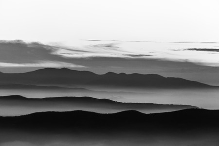 Fog filling a valley in Umbria (Italy), with layers of mountains and hills Reklamní fotografie