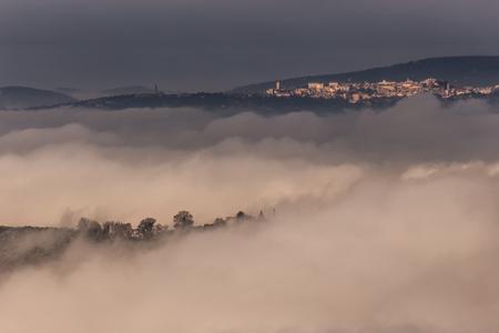 A view of Perugia city (Umbria, Italy) above a sea of fog
