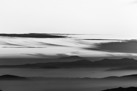 Fog filling a valley in Umbria (Italy), with layers of mountains and hills 写真素材