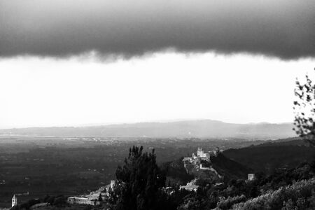 Beautiful view of Rocca Maggior castle (Assisi, Umbria, Italy) with distant hills in the background Imagens