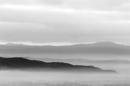 A view of Umbria valley with hills and mist