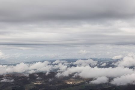 View from above of Umbria valley, with cloudscape both above and below