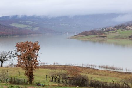 View of Montedoglio lake (Tuscany, Italy) with mist above it